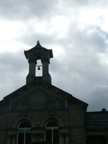 he school bell, complete with pigeon and typically gloomy skies