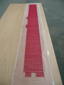 My husband's favourite. German artist Katharina Hinsberg used a single red thread and ran it round the perimeter of the Spinning Room. Then she wove the thread into an exact floor plan at the ratio of 1:100. It was still a massive piece of work, reflecting the size of the room