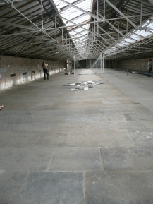 """The handkerchief """"flagstones"""" seen as part of the whole expanse of the floor"""