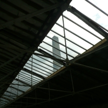 View through the glass roof of the Spinning Room, and the mill chimney